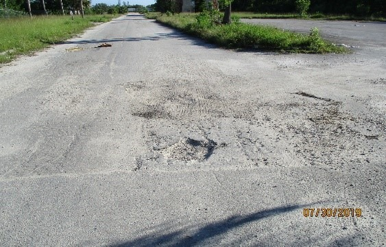 A small pothole is forming on Union Road on the east side of the old hotel.